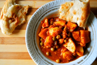 indian curry with potatoes, chickpeas, and peas