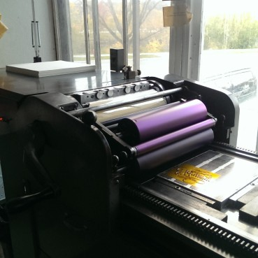 pretty ink on the rollers! and look at that huge stack of paper I have to print...